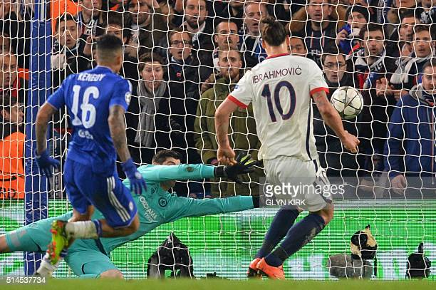 Paris SaintGermain's Swedish forward Zlatan Ibrahimovic slots the ball past Chelsea's Belgian goalkeeper Thibaut Courtois to score his team's second...