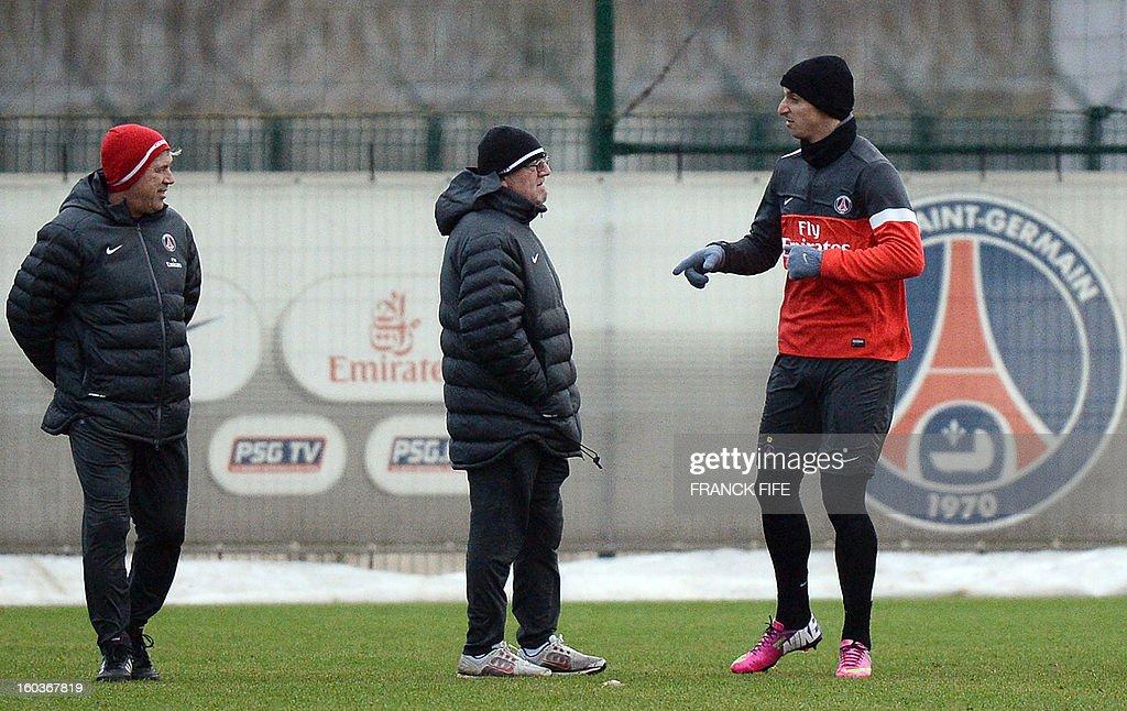 Paris Saint-Germain's Swedish forward Zlatan Ibrahimovic (R) speaks with Paris Saint-Germain's coach Carlo Ancelotti (L) and fitness coach Giovanni Mauri (C) during a training session on January 30, 2013 at the Camp des Loges in Saint-Germain-en-Laye, west of Paris.