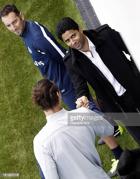 Paris SaintGermain's Swedish forward Zlatan Ibrahimovic speaks with Chairman of the Paris SaintGermain L1 football club Nasser AlKhelaifi of Qatar...