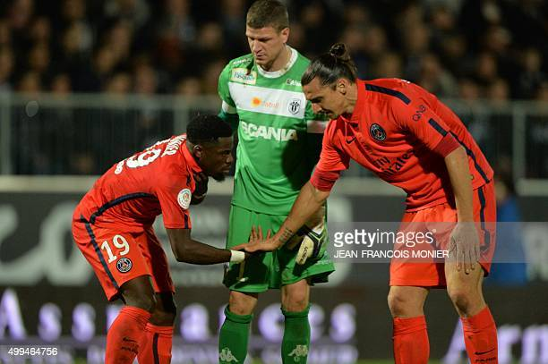 Paris SaintGermain's Swedish forward Zlatan Ibrahimovic taps hands with Paris SaintGermain's Ivorian defender Serge Aurier during the French L1...