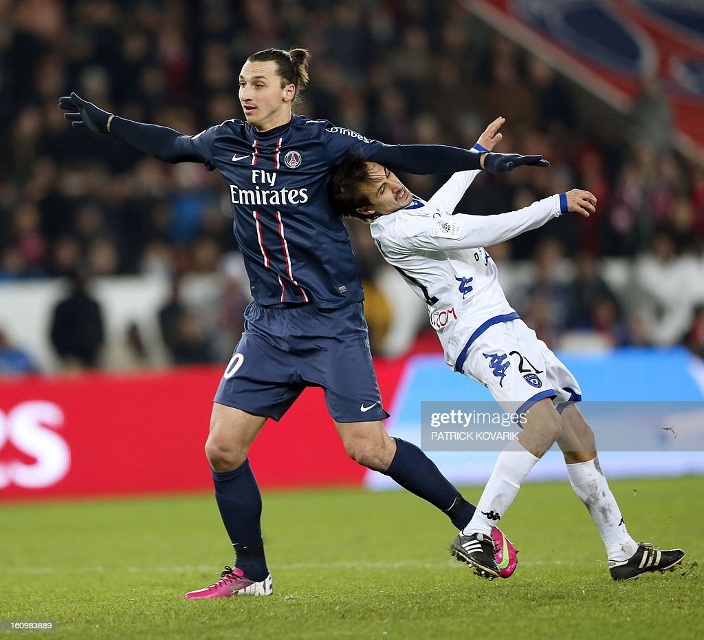 Paris Saint-Germain's Swedish forward Zlatan Ibrahimovic (L)vies with Bastia's Fehti Harek during the French L1 football match Paris Saint-Germain (PSG) vs Bastia, on February 8, 2013 at the Parc des Princes stadium in Paris.