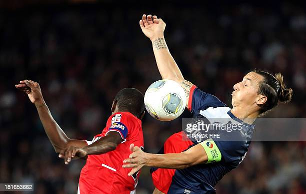 Paris SaintGermain's Swedish forward Zlatan Ibrahimovic vies with Monaco's French defender Eric Abidal during the French L1 football match between...