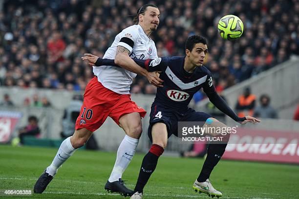 Paris SaintGermain's Swedish forward Zlatan Ibrahimovic vies with Bordeaux's Portuguese defender Tiago Ilori during the French L1 football match...