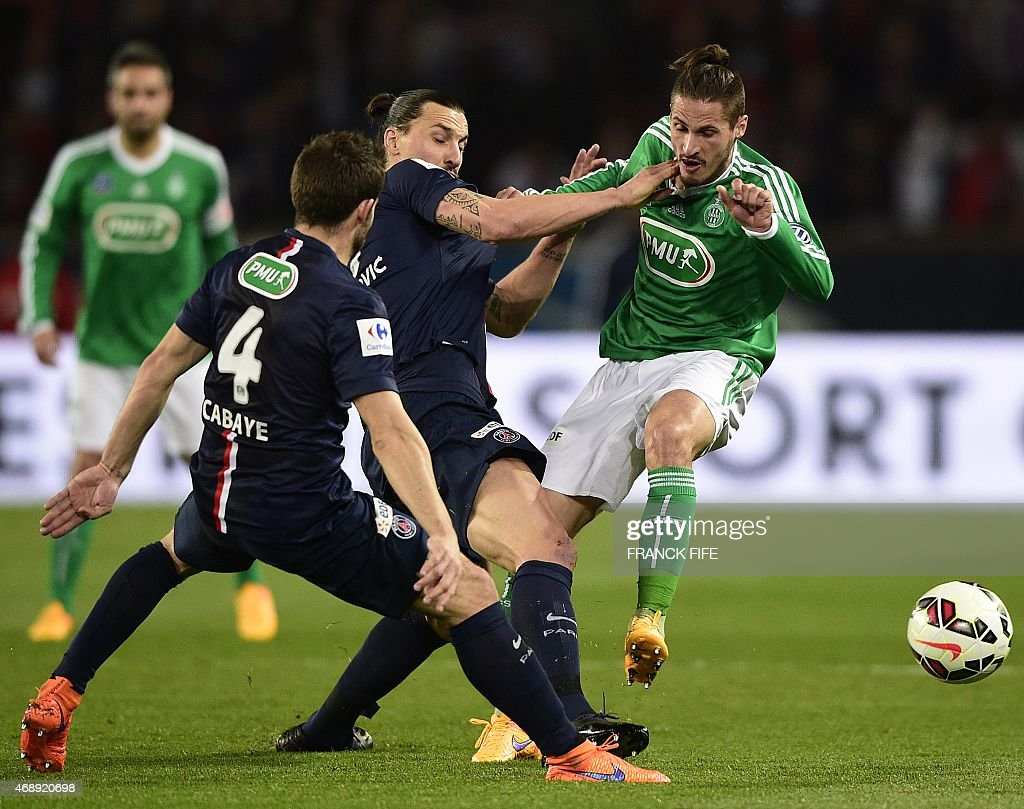 Paris Saint-Germain's Swedish forward <a gi-track='captionPersonalityLinkClicked' href=/galleries/search?phrase=Zlatan+Ibrahimovic&family=editorial&specificpeople=206139 ng-click='$event.stopPropagation()'>Zlatan Ibrahimovic</a> (C) vies with Saint-Etienne's French midfielder <a gi-track='captionPersonalityLinkClicked' href=/galleries/search?phrase=Jeremy+Clement&family=editorial&specificpeople=648908 ng-click='$event.stopPropagation()'>Jeremy Clement</a> (R) during the French Cup semi-final football match Paris Saint-Germain (PSG) vs Saint-Etienne (ASSE) on April 8, 2015 at the Parc des Princes stadium in Paris. AFP PHOTO / FRANCK FIFE