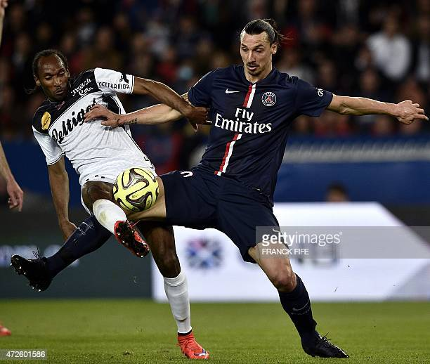 Paris SaintGermain's Swedish forward Zlatan Ibrahimovic vies with Guingamp's French defender Jeremy Sorbon during the French L1 football match...