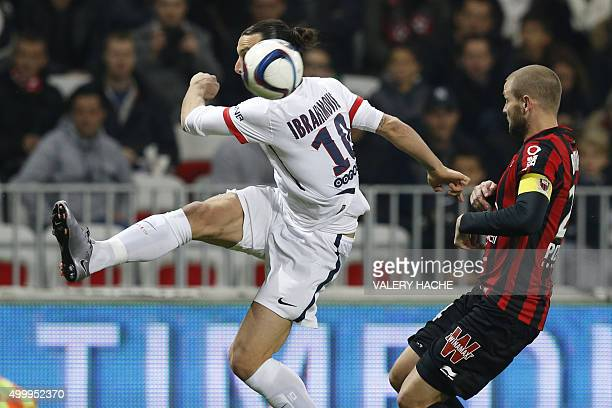 Paris SaintGermain's Swedish forward Zlatan Ibrahimovic vies with Nice's French midfielder Mathieu Bodmer during the French L1 football match Nice vs...