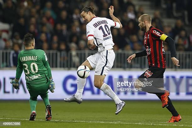 Paris SaintGermain's Swedish forward Zlatan Ibrahimovic vies with Nice's French goalkeeper Yoan Cardinale and Nice's French midfielder Mathieu Bodmer...