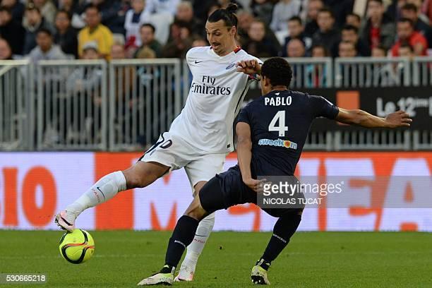 Paris SaintGermain's Swedish forward Zlatan Ibrahimovic vies with Bordeaux' Brazilian defender Pablo during the French L1 football match between...