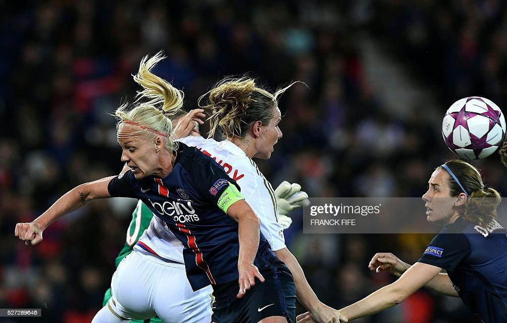 Paris Saint-Germain's Swedish midfielder Caroline Seger (L) challenges Lyon's French midfielder Amandine Henry (back C) during the UEFA Women's Champions League semi-final second leg football match between Paris Saint-Germain (PSG) and Lyon at the Parc des Princes stadium in Paris on May 2, 2016. / AFP / FRANCK