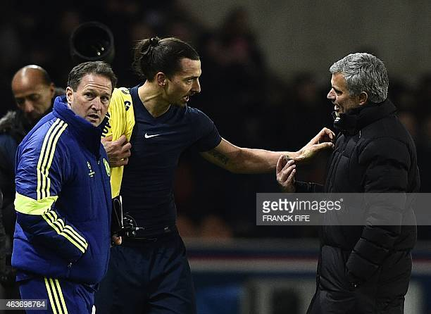 Paris SaintGermain's Swedish midfielder Zlatan Ibrahimovic speaks with Chelsea's Portuguese manager Jose Mourinho at the end of the UEFA Champions...