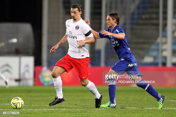 Paris SaintGermain's Swedish midfielder Zlatan Ibrahimovic vies for the ball with Bastia's French midfielder Guillaume Gillet during the French L1...