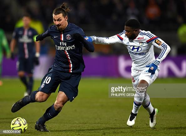 Paris SaintGermain's Swedish midfielder Zlatan Ibrahimovic vies with Lyon's French midfiedler Arnold Mvuemba during the French L1 football match...