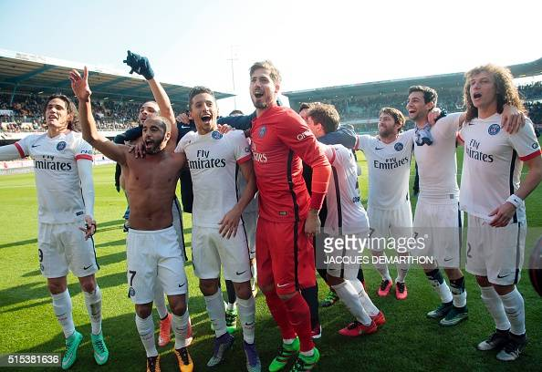 Paris SaintGermain's team celebrates with its supporters after winning over Troyes during the French Ligue 1 football match on March 13 2016 at the...