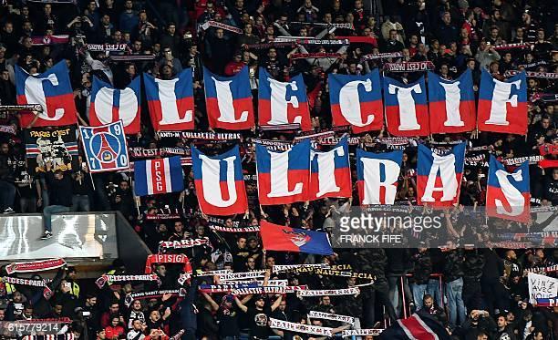 TOPSHOT Paris SaintGermain's ultrafanatical fans knows as Ultras cheer during the UEFA Champions League group A football match between Paris...