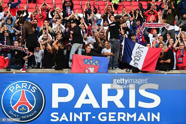 Paris SaintGermain's ultras applaud and chant following the French L1 football match between Paris SaintGermain and Bordeaux at the Parc des Princes...