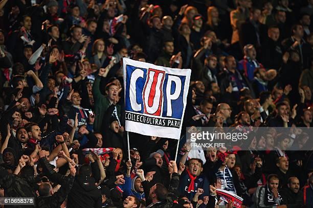 Paris SaintGermain's ultras cheer during the UEFA Champions League group A football match between Paris SaintGermain and Basel at the Parc des...