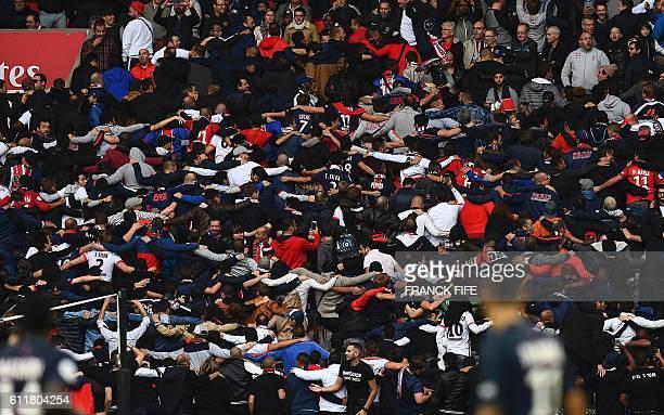 Paris SaintGermain's ultras react during the French L1 football match between Paris SaintGermain and Bordeaux at the Parc des Princes stadium in...