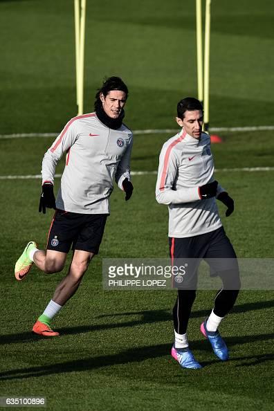 Paris SaintGermain's Uruguayan forward Edinson Cavani and Argentinian midfielder Angel Di Maria take part in a training session on February 13 2017...