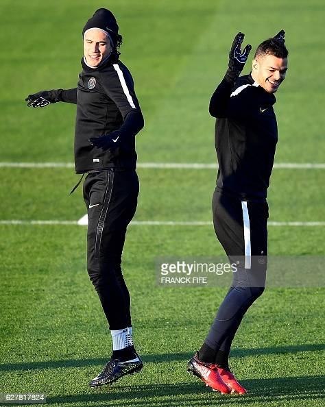 Paris SaintGermain's Uruguayan forward Edinson Cavani and Paris SaintGermain's French forward Hatem Ben Arfa take part in a training session on...
