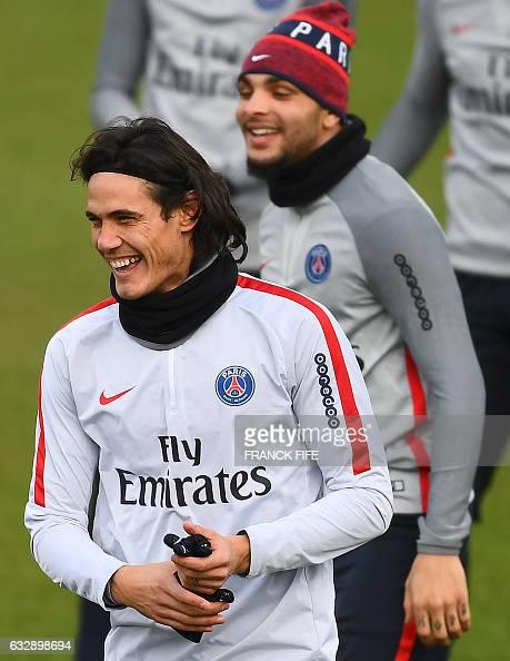 Paris SaintGermain's Uruguayan forward Edinson Cavani and Paris SaintGermain's French defender Layvin Kurzawa smile during a training session on...