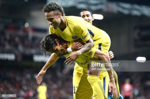 Paris SaintGermain's Uruguayan forward Edinson Cavani and Paris SaintGermain's Brazilian forward Neymar celebrate during the French L1 football match...
