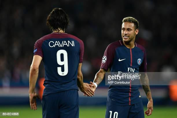 TOPSHOT Paris SaintGermain's Uruguayan forward Edinson Cavani and Paris SaintGermain's Brazilian forward Neymar shake hands during the UEFA Champions...