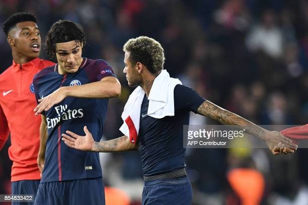 TOPSHOT Paris SaintGermain's Uruguayan forward Edinson Cavani and Paris SaintGermain's Brazilian forward Neymar celebrate after winning the UEFA...