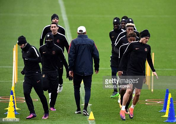 Paris SaintGermain's uruguayan forward Edinson Cavani and teammates run during a training session at the Ooredoo PSG training center on October 18...