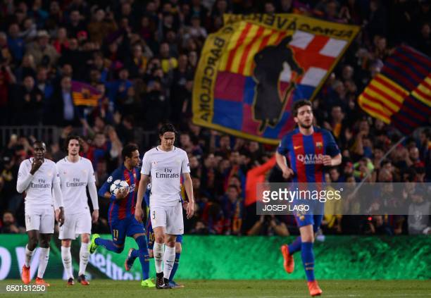 Paris SaintGermain's Uruguayan forward Edinson Cavani and teammates walk on the pitch after Barcelona's Brazilian forward Neymar scored his team's...
