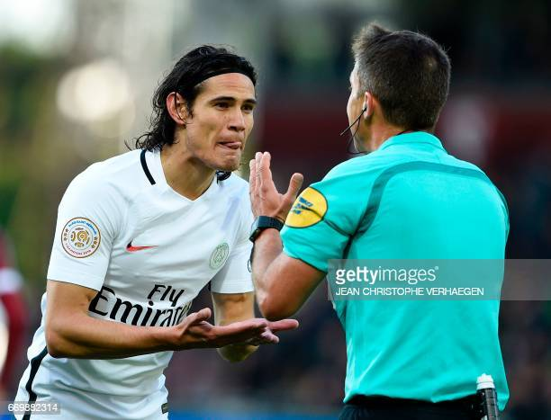 Paris SaintGermain's Uruguayan forward Edinson Cavani argues with main referee Johan Hamel gestures during the French L1 football match between Metz...