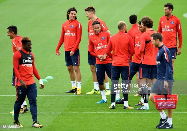 Paris SaintGermain's Uruguayan forward Edinson Cavani Brazilian forward Neymar Ivorian defender Serge Aurier and teammates take part in a training...