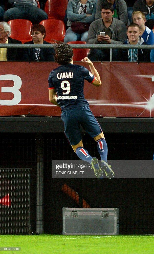 Paris Saint-Germain's Uruguayan forward Edinson Cavani celebrates after scoring during a French L1 football match between Valenciennes and Paris Saint-Germain on September 25, 2013 at the Stade du Hainaut in Valenciennes, northern France.
