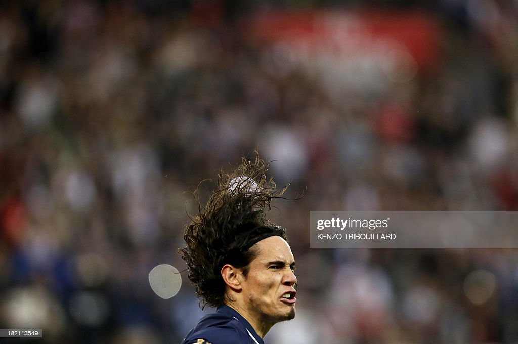 Paris Saint-Germain's Uruguayan forward Edinson Cavani celebrates after scoring his team's second goal during the French L1 football match between Paris Saint-Germain and Toulouse at the Parc des Princes Stadium in Paris on September 28, 2013.