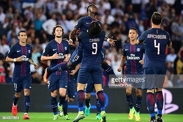 Paris SaintGermain's Uruguayan forward Edinson Cavani celebrates after scoring with his teammate Paris SaintGermain's Ivorian defender Serge Aurier...