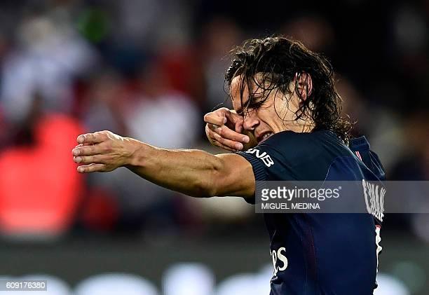TOPSHOT Paris SaintGermain's Uruguayan forward Edinson Cavani celebrates after scoring a penalty during the French L1 football match between Paris...