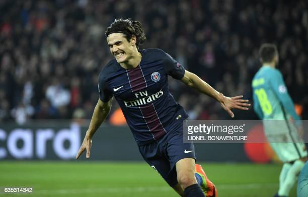 TOPSHOT Paris SaintGermain's Uruguayan forward Edinson Cavani celebrates after scoring a goal during the UEFA Champions League round of 16 first leg...