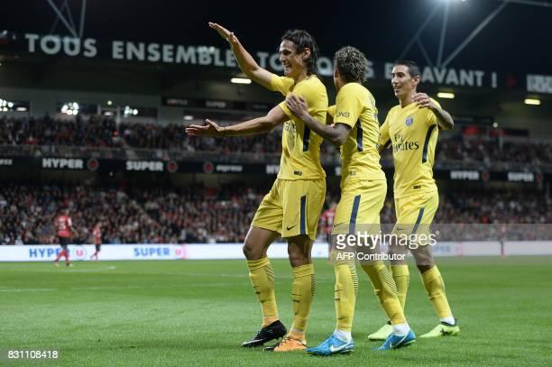 Paris SaintGermain's Uruguayan forward Edinson Cavani celebrates after scoring a goal with Paris SaintGermain's Brazilian forward Neymar and Paris...