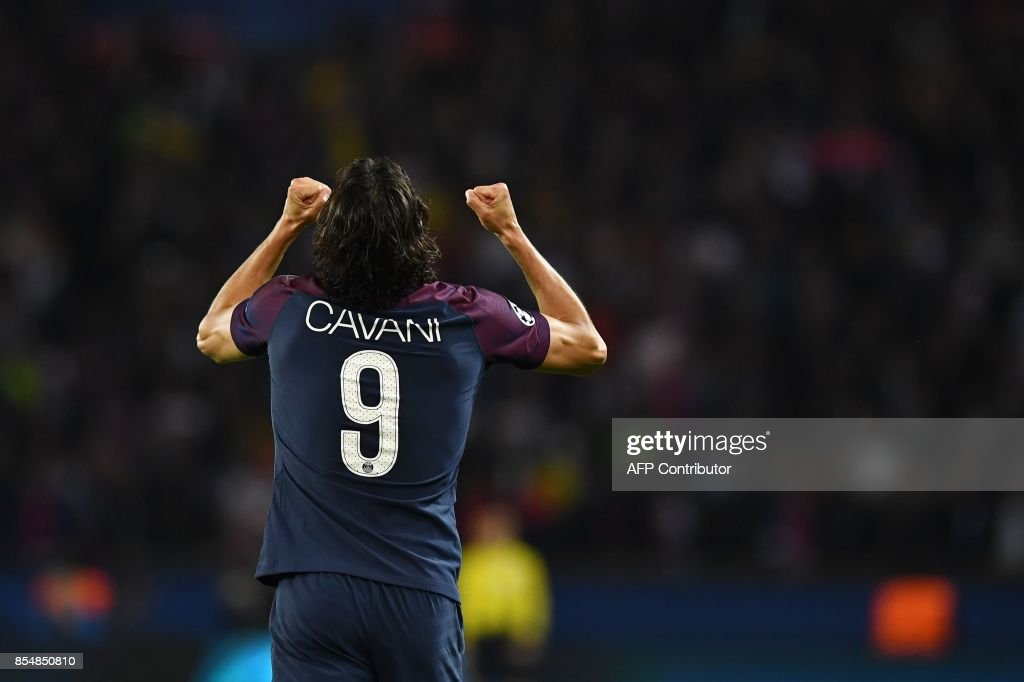 Paris Saint-Germain's Uruguayan forward Edinson Cavani celebrates after scoring a goal during the UEFA Champions League football match between Paris Saint-Germain and Bayern Munich on September 27, 2017 at the Parc des Princes stadium in Paris. /