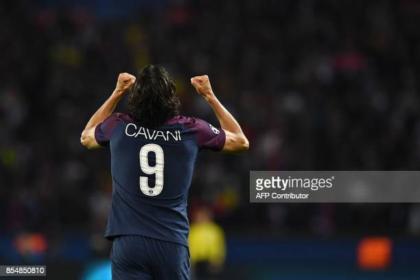 Paris SaintGermain's Uruguayan forward Edinson Cavani celebrates after scoring a goal during the UEFA Champions League football match between Paris...