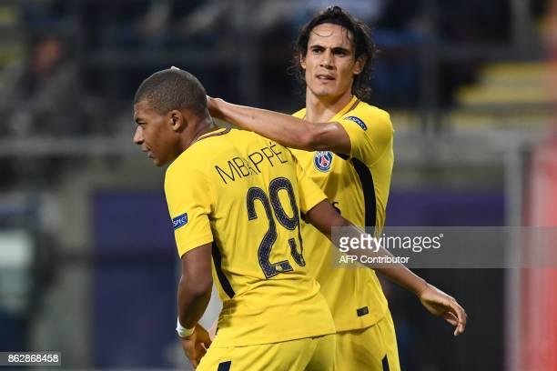 Paris SaintGermain's Uruguayan forward Edinson Cavani celebrates after scoring a goal with Paris SaintGermain's French forward Kylian Mbappe during...