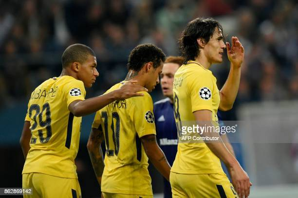 Paris SaintGermain's Uruguayan forward Edinson Cavani celebrates after scoring a goal with Paris SaintGermain's French forward Kylian Mbappe and...