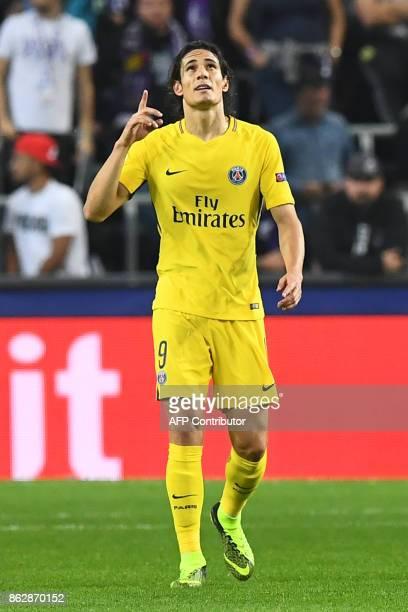 Paris SaintGermain's Uruguayan forward Edinson Cavani celebrates after scoring a goal during the UEFA Champions League Group B football match between...
