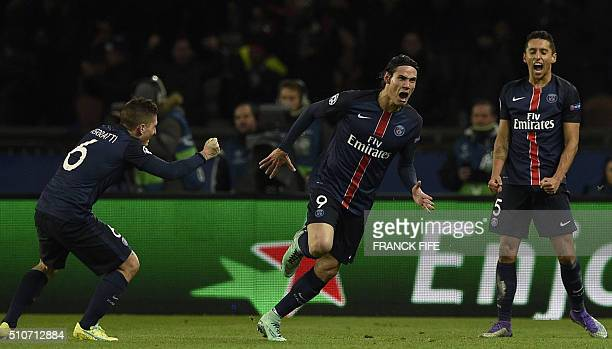 Paris SaintGermain's Uruguayan forward Edinson Cavani celebrates scoring the 21 next to Paris SaintGermain's Italian midfielder Marco Verratti and...