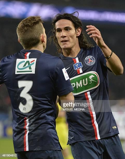 Paris SaintGermain's Uruguayan forward Edinson Cavani celebrates with Paris SaintGermain's French defender Lucas Digne after scoring during the...