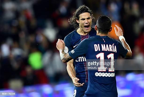 TOPSHOT Paris SaintGermain's Uruguayan forward Edinson Cavani celebrates with Paris SaintGermain's Argentinian forward Angel Di Maria after scoring a...