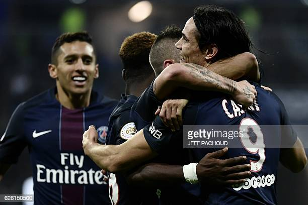 Paris SaintGermain's Uruguayan forward Edinson Cavani celebrates with his teammates after scoring a goal during the French L1 football match between...