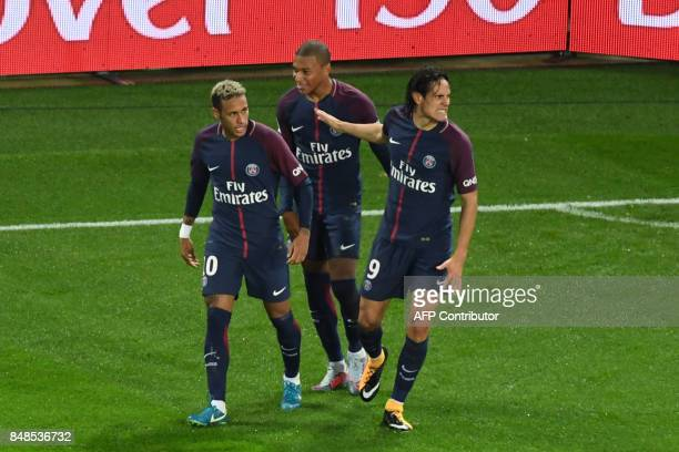Paris SaintGermain's Uruguayan forward Edinson Cavani celebrates with Paris SaintGermain's Brazilian forward Neymar and Paris SaintGermain's French...