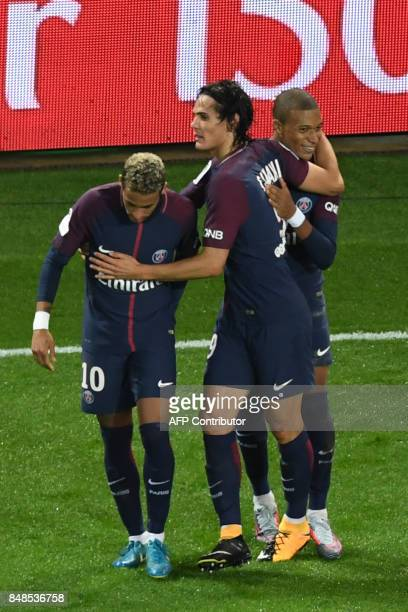 Paris SaintGermain's Uruguayan forward Edinson Cavani celebrates with Paris SaintGermain's Brazilian forward Neymar and Paris SaintGermain's French...
