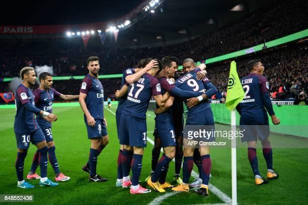 Paris SaintGermain's Uruguayan forward Edinson Cavani celebrates with teammates Paris SaintGermain's Brazilian defender Thiago Silva Paris...