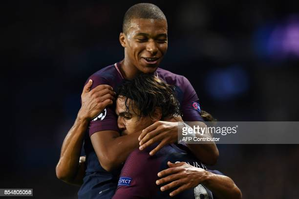 Paris SaintGermain's Uruguayan forward Edinson Cavani celebrates with Paris SaintGermain's French forward Kylian Mbappe after scoring a goal during...